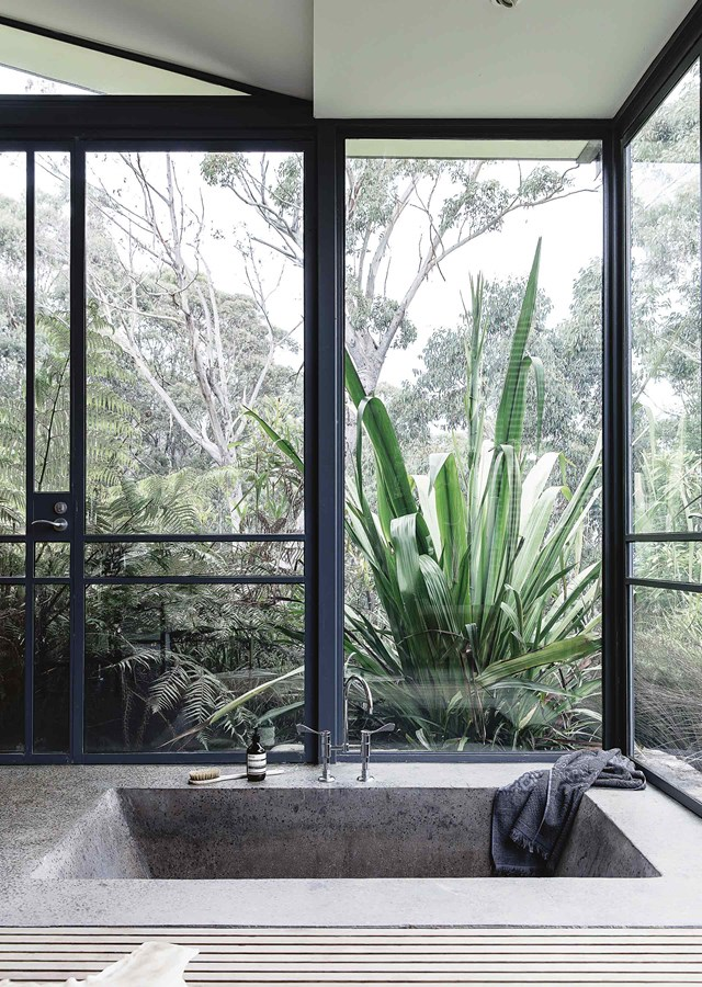 "It's hard to tell where the outdoors end and indoors begin in this [enchanting Blue Mountains home](https://www.homestolove.com.au/its-only-natural-an-enchanting-blue-mountains-home-12157|target=""_blank""). While a free-standing bath would have worked perfectly fine in this space, a sunken tub takes things to the next level. Just imagine what it would be like to stargaze, or watch the sunset from here. *Photo: Maree Homer / Styling: Kerrie-Ann Jones / Story: Country Style*"