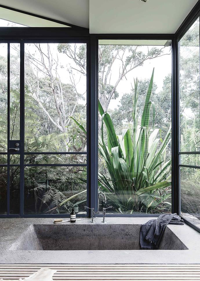 In the bathroom, a deep sunken bath offers a luxurious hideaway from the world.