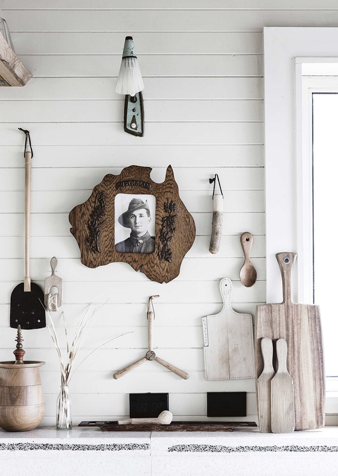 A collection of quirky Australiana homewares found in secondhand shops and on eBay — such these timber objects and a photo of an unknown soldier — add a layer of personality.
