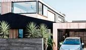 Modern design meets family living in this beachside beauty