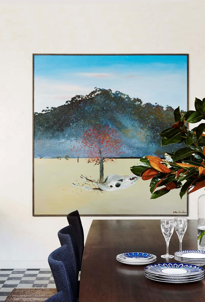 "A dramatic artwork by [Arthur Boyd](https://www.homestolove.com.au/artist-arthur-boyds-elegant-country-home-13391|target=""_blank"") commands attention at one end of the custom 3.5m table in salvaged turpentine by Wright Studios."