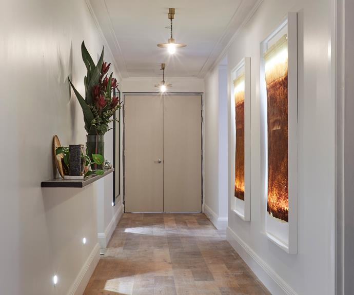 **Hayden and Sara** The backlit Kinwashi artworks added a soft and dreamy feel to the hallway.
