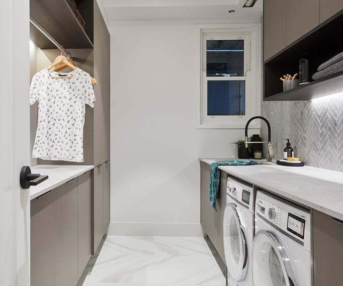 **Kerrie and Spence** Luxe tiles with ample space and storage has this laundry ticking all the boxes.