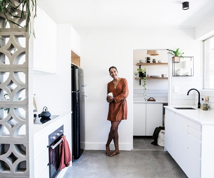 Mariah Burton in the kitchen of her renovated Dee Why apartment
