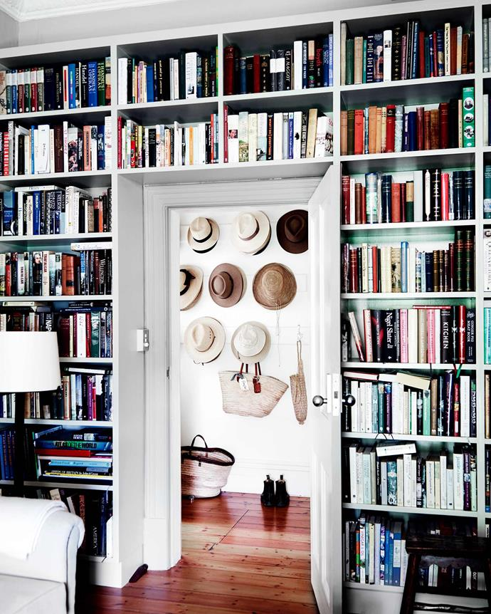 A doorway in the library reveals a wonderful hat collection in the hall. *  Photography: Mark Roper   Styling: Tess Newman-Morris*