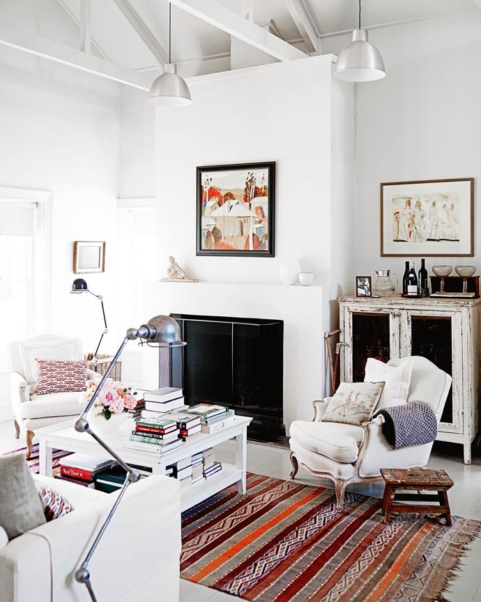 "A pair of French bergère chairs around a Moroccan rug are overlooked by a country homestead painting by South Australia's Dieter Engler and a work by Austrian artist Mario Dalpra above the cabinet. The living room is lit by pedant lamps from [The Conran Shop](https://www.conranshop.co.uk/|target=""_blank""