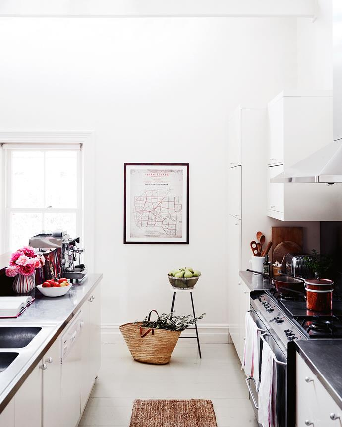 The kitchen wall displays a map of the large Hynam Estate pastoral property in 1908 when its subdivision led to the founding of Gum Park by Dee's grandfather. *  Photography: Mark Roper   Styling: Tess Newman-Morris*