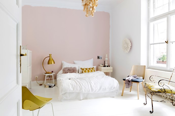 If you want to give a feature wall a go, but aren't particularly neat, try Christine's method. Using a roller, paint your wall about 5-10cm in from the edges on all sides. Accent the look with frayed-edge cushions and throws.