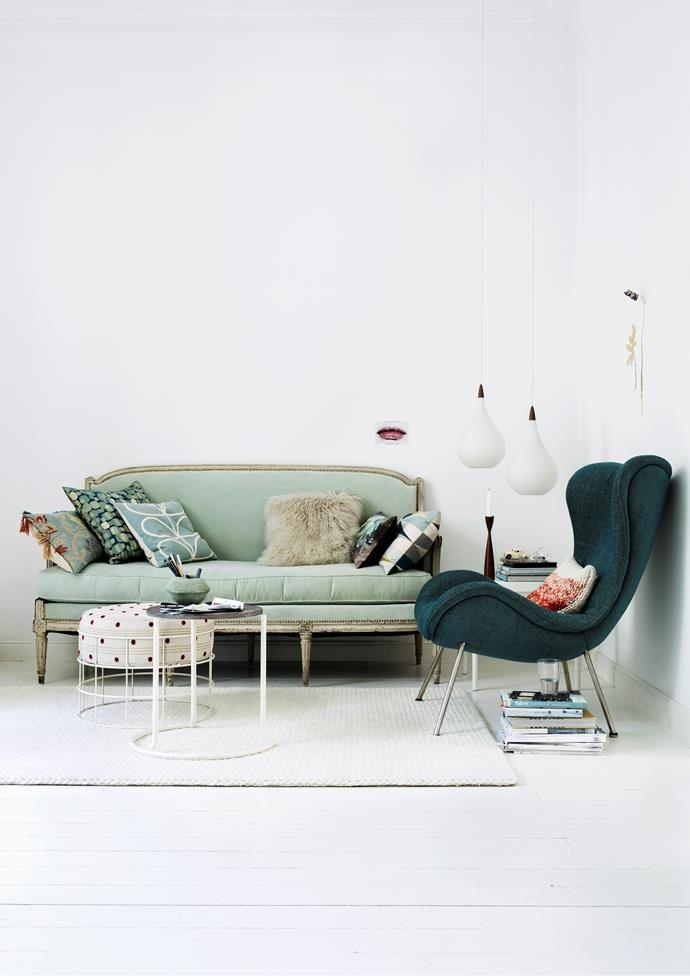 """Christine found the Louis XVI sofa in Paris and had it reupholstered in green velvet. The Scandinavian [pendant lights](https://www.homestolove.com.au/14-pendant-lights-that-pack-a-punch-2989