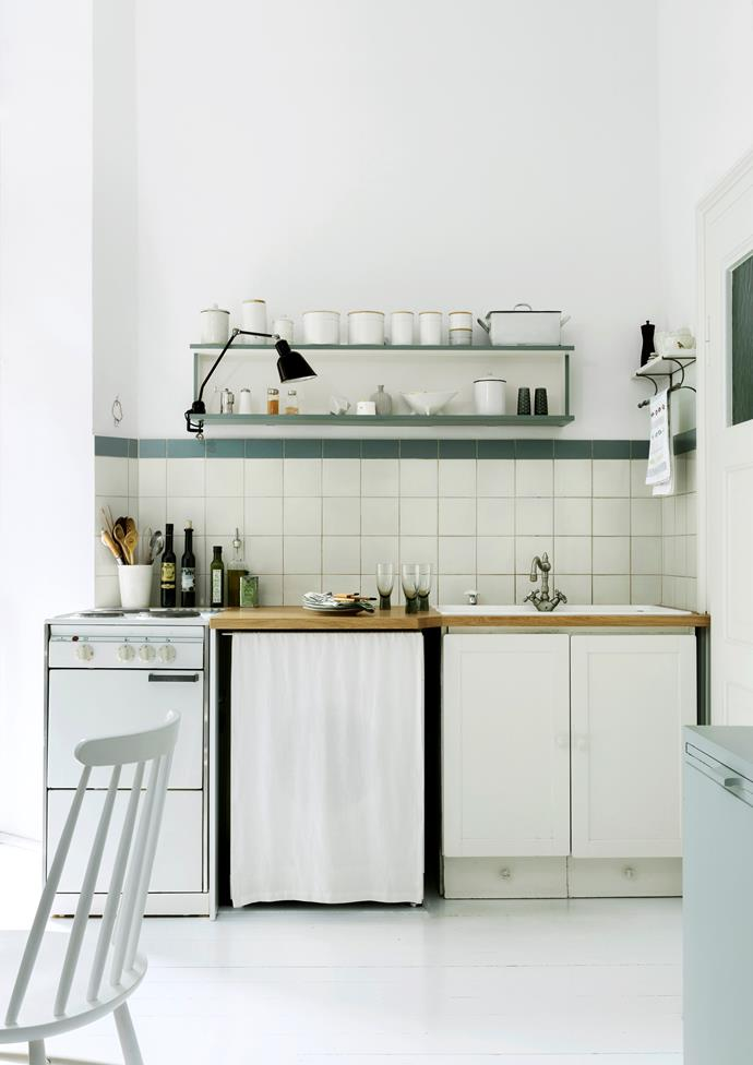 Built-in kitchens aren't Christine's style. Instead, she furnished hers with individually made cabinets, some painted in a mint-green shade that she mixed herself. The mid-century shelving was originally in the living room during the apartment's 1960s phase.