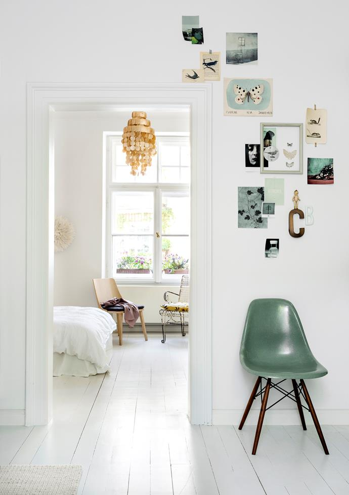 """Rather than hanging heavy, framed pictures, Christine creates collages of photographs, small objects and postcards that she adds to and changes according to her mood. An original [Eames chair](https://www.homestolove.com.au/charles-and-ray-eames-15217