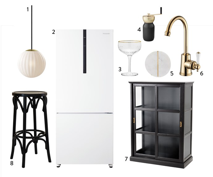 "1. Nordic Tales ""Bright Modeco"" **pendant** light, $249, Surrounding. 2. Panasonic 407L bottom-mount **fridge** in White, $999, Harvey Norman. 3. Bloomingville Champagne **glass** in Clear, $23, Clickon Furniture. 4. Stelton ""Collar"" **coffee grinder**, $199.90, Top3 By Design. 5. Marbella **coaster** in White Marble, $25 for set of 4, Freedom. 6. Kado ""Classic"" **sink mixer** in Porcelain Brass Gold, $550, Reece. Malsjo glass-door **cabinet** in Black, $499, Ikea. 8. Round Tall **barstool** in Black, $265.10, Thonet."