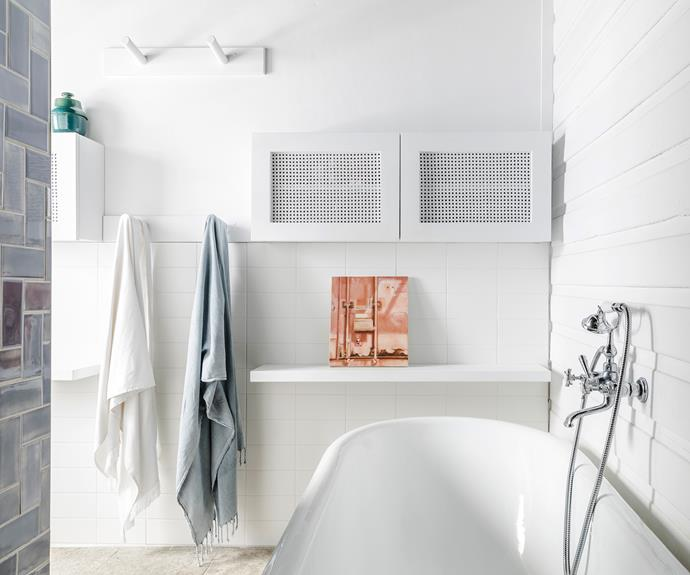 """**Bathroom** Less is more. The old home had two adjoining small bathrooms, which Kate and David turned into one large main space. """"White wall tiles tie in well with the sealed tongue-and-groove wall,"""" says Kate. The artwork, by Helen Redmond, brings a splash of colour. Nucast bath, [Nupride](https://www.nupride.com.au/