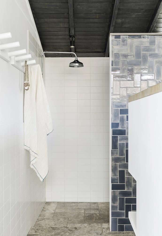 """**Ensuite** Travertine floor tiles from My Stone ground the parents' retreat, which features the same finishes as the other bathrooms. A pendant light from The Society Inc is an added touch. Tapware, [Brodware](https://brodware.com/about-us/