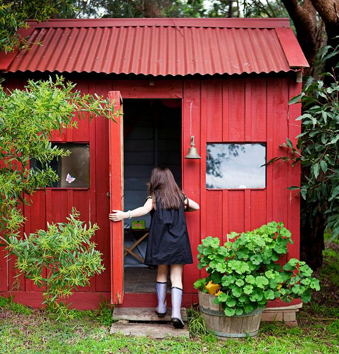 This family converted a small wooden shed in the backyard into a cubby and painted it bright red for a 70s feel.
