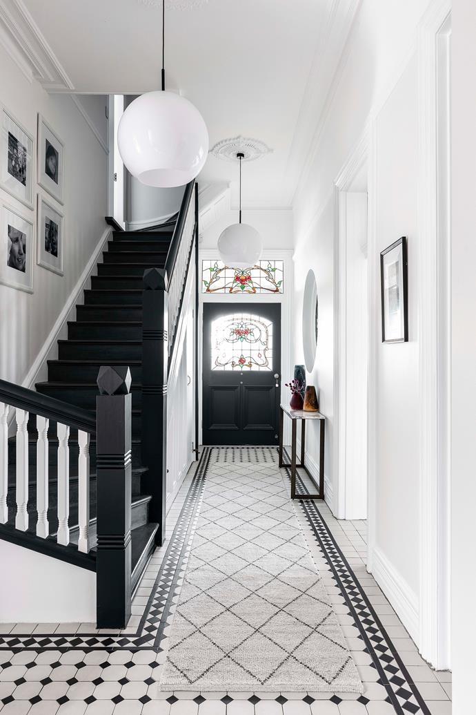 In the hallway, the original tiled floors were cleaned and restored.