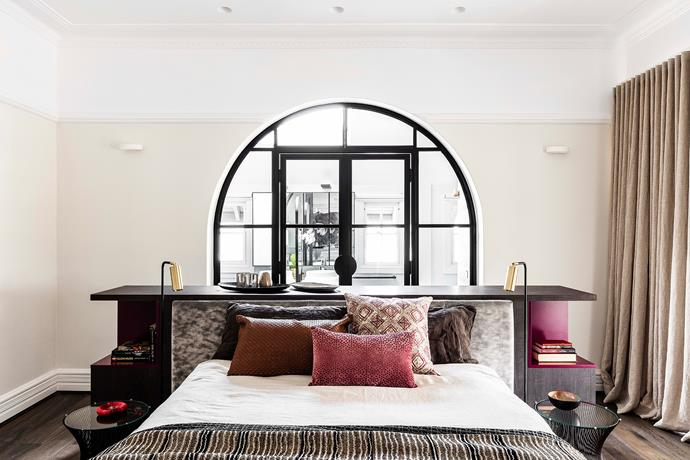 In the main bedroom, a set of custom steel-arch doors by Fabrika Engineering lets in plenty of natural sunlight.