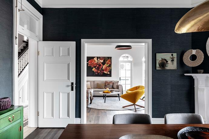 A wide doorway connects the formal dining room to the home's living area.