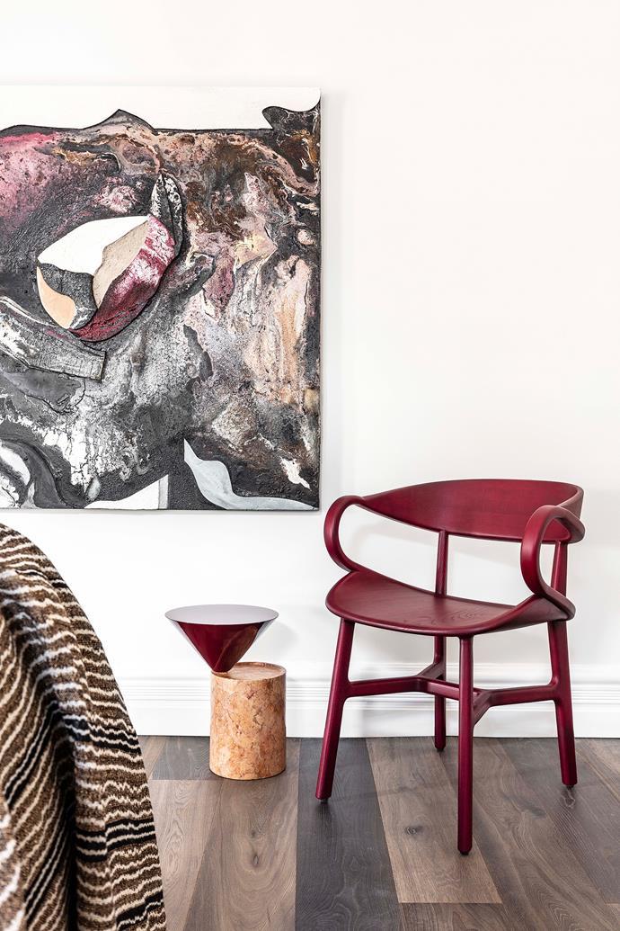 De La Espada chair and side table, both from Spence & Lyda, beside an artwork by Eduardo Santos.