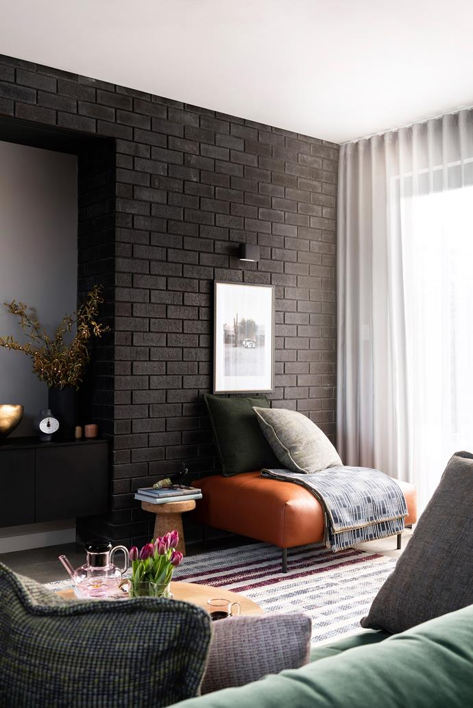 Bricks in moodier shades are being used to create drama and texture in modern homes.