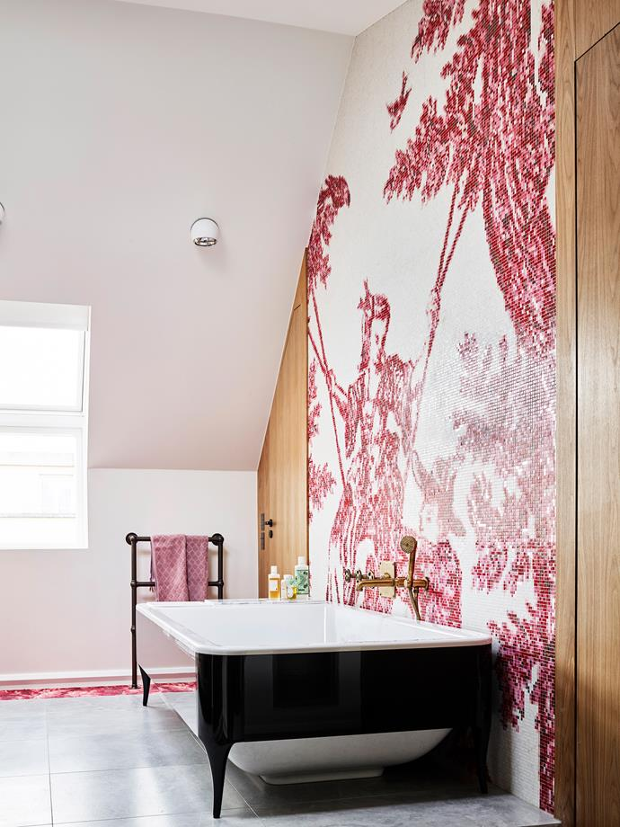 "In the main bathroom, bold pink mosaic tiles from Bisazza depict a Chinese imperial art scene. The ""Organico"" tub is also from Bisazza's Hayon Collection."