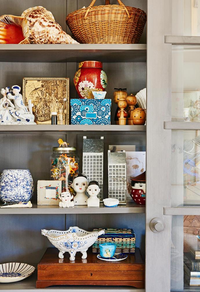 """**Living area** """"I've filled this large cabinet with sentimental pieces,"""" says Kristen."""