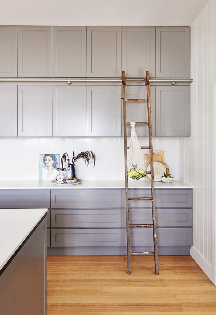 """**Bright idea** """"I found the timber library ladder in the kitchen in a wrecking yard,"""" says Kristen. """"It's great when you need to reach something in the top cupboards."""" It runs on a rail installed by Built By Wilson."""