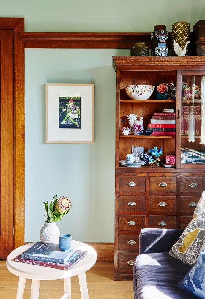 """**Formal living area** Two living areas mean space for family and friends. The custom armchair and couch are by Comer & King, and the print is by HelloMarine. """"We call her 'the lady with green legs',"""" says Kristen. Cabinet, [Kyo](http://kyo.net.au/ target=""""_blank"""" rel=""""nofollow"""")."""