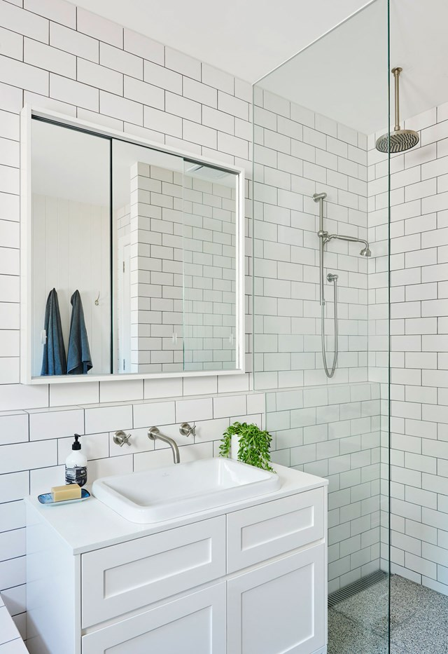 "Classic meets trendy in the main bathroom of a [refreshed Californian bungalow](https://www.homestolove.com.au/a-clever-extension-refreshed-this-1920s-californian-bungalow-19106|target=""_blank""). Terrazzo floor tiles have been paired with white subway tiles to create a family-friendly space that is easy on the eye. *Photo: Nikole Ramsay / Styling: Emma O'Meara*"