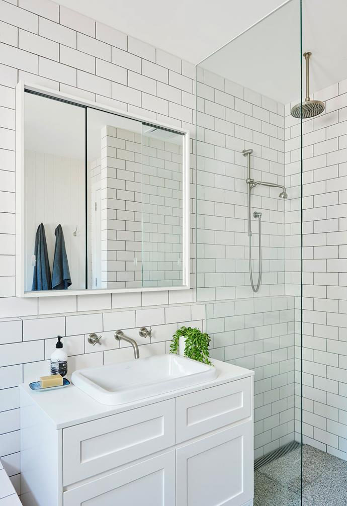 """**Bathroom** Simplicity is the theme here. A sea of crisp white includes subway tiles by Johnson Tiles and is offset by hardy terrazzo flooring from Signorino. Caesarstone in Snow tops a vanity designed by Kristen, and the tapware is from The English Tapware Company. Towel, [Atolyia](https://www.atolyia.com/ target=""""_blank"""" rel=""""nofollow"""")."""