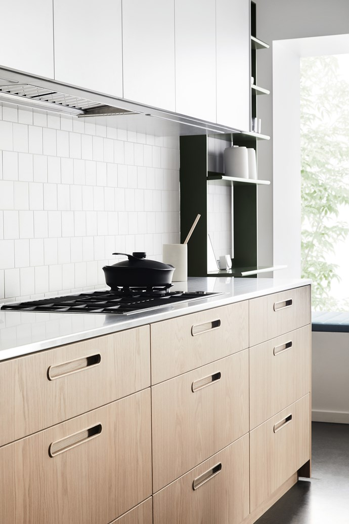 A well-lit benchtop is crucial. Choose a rangehood with lights and install downlights or strip lighting in overhead cabinets.