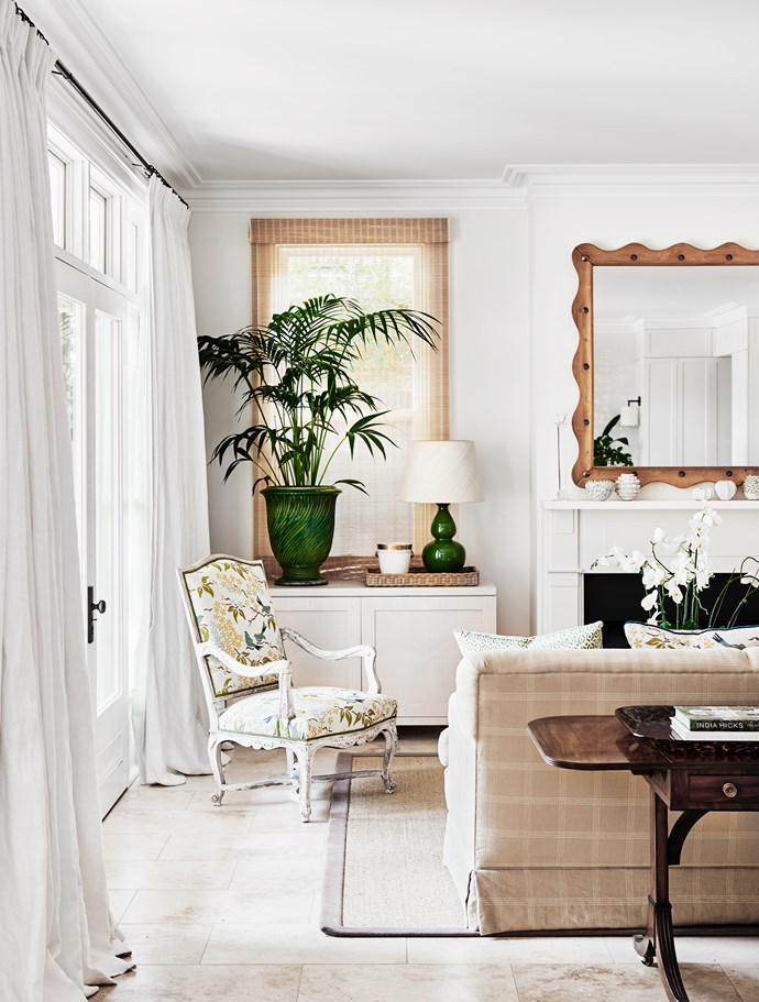"""An antique armchair from Parterre is has been re-upholstered in fabric from Galbraith & Paul while the lamp is from [Bragg & Co](https://braggandco.com.au/collections/pop-range/products/jungle-green-double-gourd target=""""_blank"""" rel=""""nofollow"""")."""