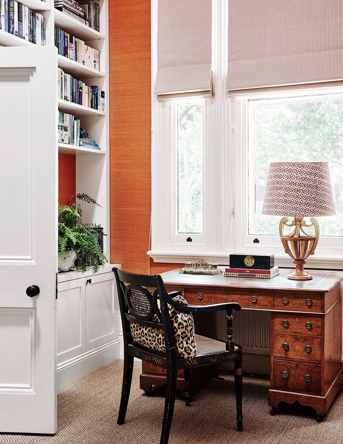 """Rust-orange seagrass wallpaper allows the earthy tones in the home office - set within the formal living room - to pop. Custom-joinery was added to this multi-purpose space which functions as a [home library](https://www.homestolove.com.au/best-home-library-designs-3504 target=""""_blank"""") as well as a living space."""