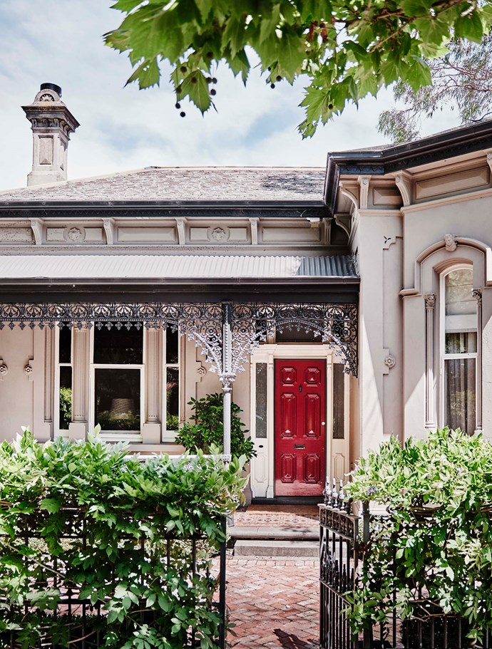 The original 1800s facade of the home has been retained, complete with filigree ironwork.