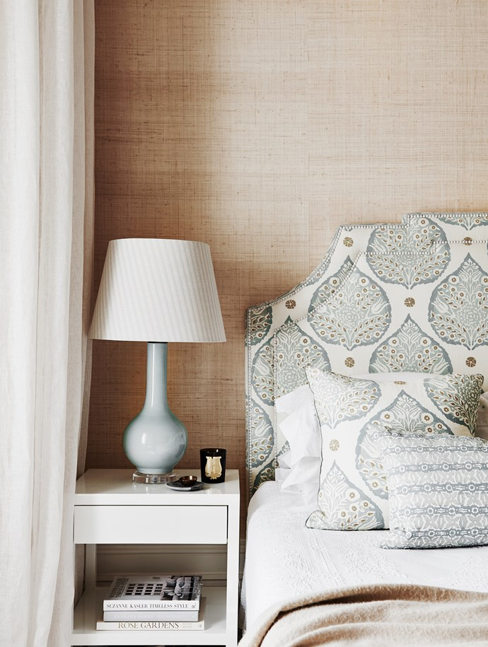 """A statement bedhead was reupholstered with fabric from [Galbraith & Paul](http://galbraithandpaul.com/ target=""""_blank"""" rel=""""nofollow"""") while seagrass wallpaper in a natural fosters the master bedroom's atmosphere of calm."""