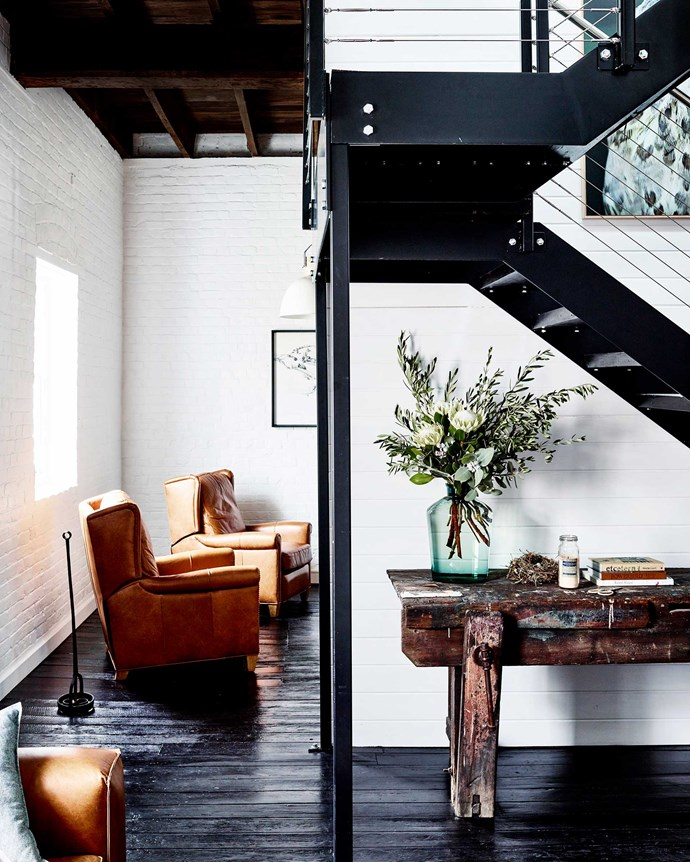 The old bench is one of the few items Belinda and Stephen brought from their former home in nearby Millthorpe. Between the sitting room and the TV area is a black steel staircase that leads to the bathroom and mezzanine-style bedroom.