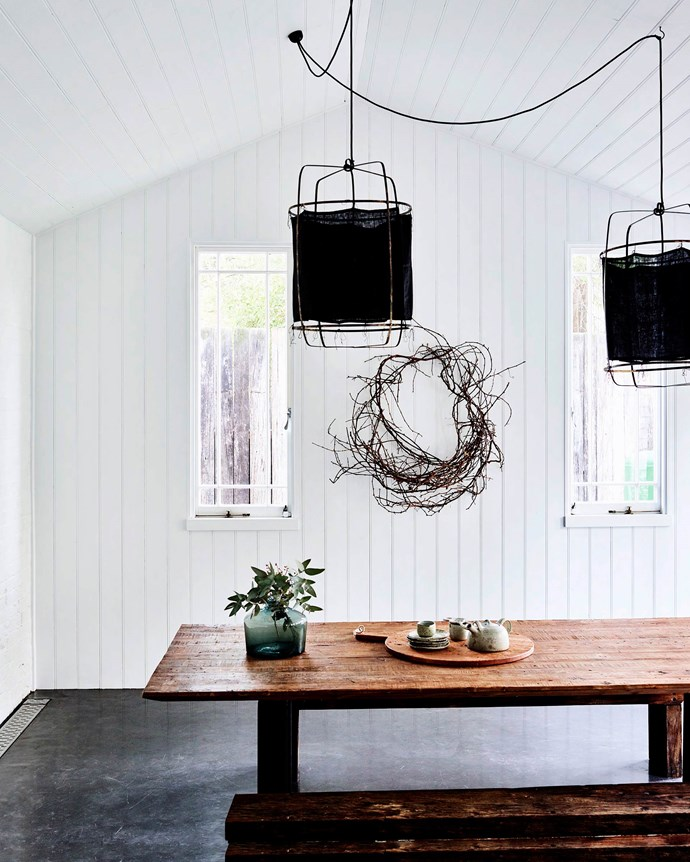 """[MRD Home](https://mrdhome.com.au/ target=""""_blank"""" rel=""""nofollow"""") pendants hang above a vase from [Bison](https://www.bisonhome.com/ target=""""_blank"""" rel=""""nofollow"""") and [Otti Made](https://www.ottimade.com.au/ target=""""_blank"""" rel=""""nofollow"""") ceramics on the table from Stone Pony. Belinda fashioned the wreath from twisted grape vines."""