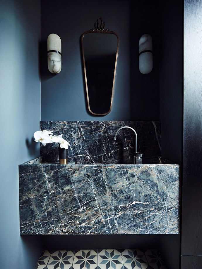 This bathroom in Killcare on the NSW Central Coast uses natural marble to create a sumptuous vanity basin. *Photography: Anton Anson Smart/bauersyndication.com.au*