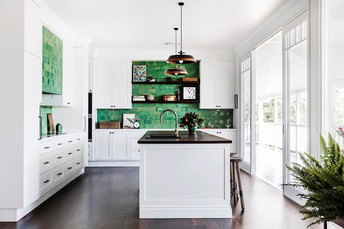Statement pieces and a bold coloured splashback ensures your kitchen demonstrates character. *Photo: Maree Homer / Bauersyndication.com.au*