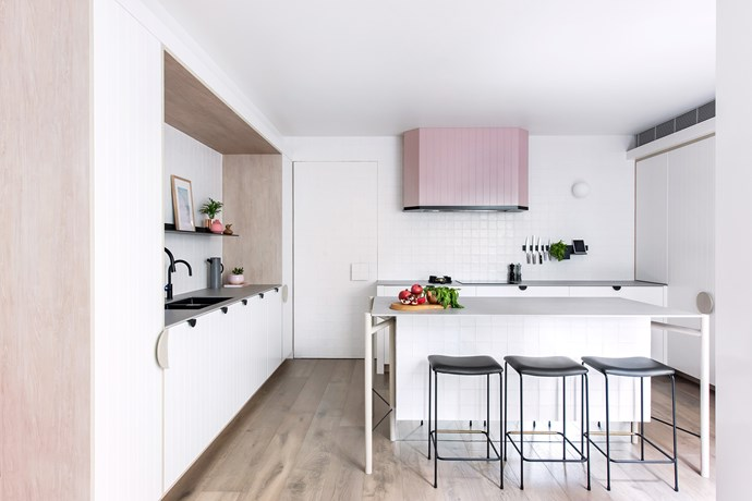 """Camouflaging the door to the garage was a priority. """"To make it disappear, we made it tall and wide, then tiled it to match the rest of the wall,"""" says Darren. """"This makes the room extend visually wall-to-wall."""""""
