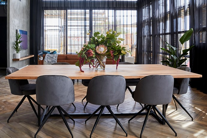**Dining room -** With it's eight-seater timber table and glamorous velvet dining chairs, we can already imagine the fancy dinner parties in this penthouse-worthy dining room. The only thing missing is gorgeous rug to pull it all together.