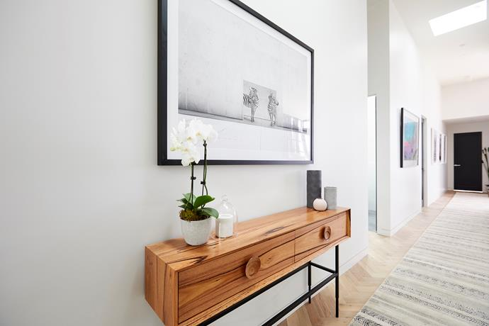 **Hallway -** Thanks to their soaring four-metre ceilings fitted with Velux skylights, Bianca and Carla's hallway was flooded with natural light, highlighting their sophisticated monochrome palette and beautiful parquetry floor.