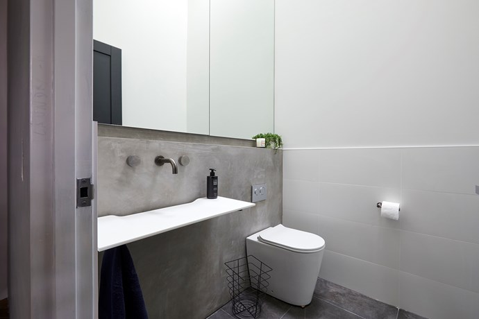 **Powder room -** The concrete splashback, towering mirror and cluster of terrazzo pendants created a sense of raw luxury that impressed the judges immensely.