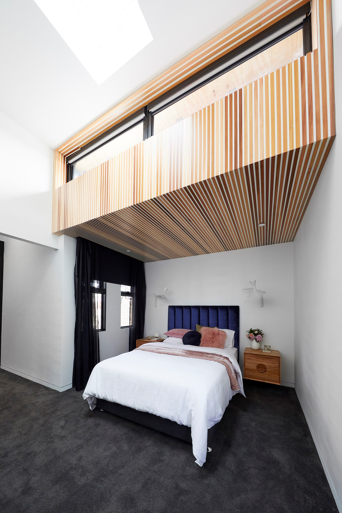 Timber cladding in the master bedroom along with bespoke bedside tables earned Bianca and Carla high praise from judges Neale, Shaynna and Darren.