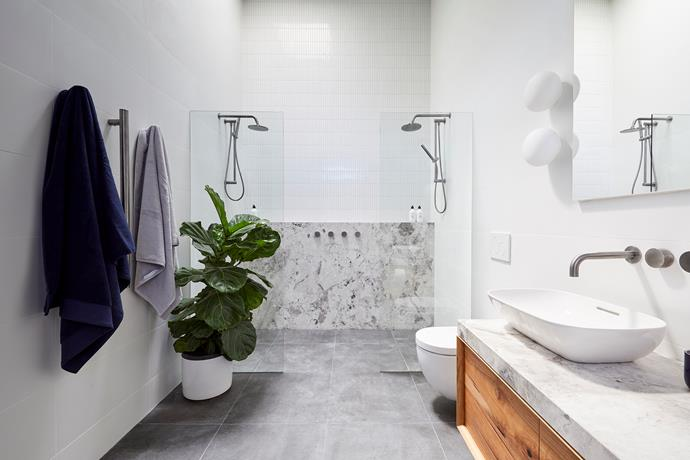 **Ensuite -** Walk through that wonderful walk-in wardrobe and into an ensuite fit for a king, featuring a double shower, double vanity and the beautiful natural stone that also features in the main bathroom.