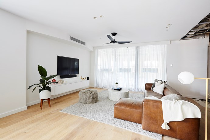 "**Informal living room** - With so much space, Hans and Courtney were able to create an informal entertainment space within their open plan dining and living room. While the judges were big fans of the idea, [buyer's advocate Frank Valentic](https://www.homestolove.com.au/the-block-2018-buyers-advocates-react-to-the-gatwick-apartments-19026|target=""_blank"") wasn't so sure how functional the side-by-side living rooms would be for his clients."