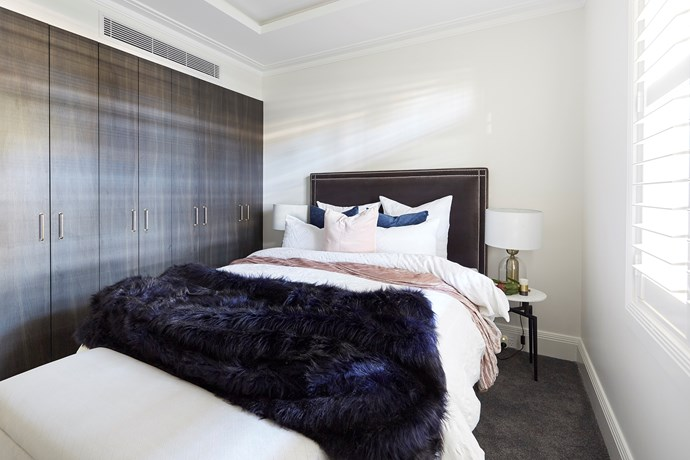 The second guest bedroom was on the small side, but that didn't stop Hayden and Sara from creating their signature coffered ceiling and packing the room stock full of storage. Even their styling was a win for the judges.