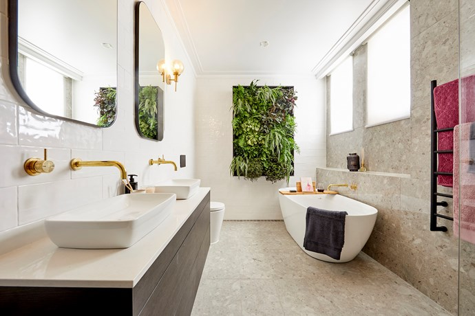 """Even with a feature green wall and brass tapware, the main bathroom completed by Hayden and Sara fell flat with the judges. [Design duo Alisa and Lysandra](https://www.homestolove.com.au/the-block-2018-bathroom-reveals-7145
