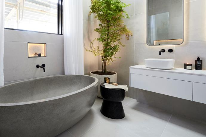 **Main bathroom -** Bathroom week was quite the rollercoaster for Norm and Jess - first it was the maple tree then it was the fiberglass bath fiasco - but in the end they delivered a luxurious, spa-like retreat perfect for their penthouse digs.