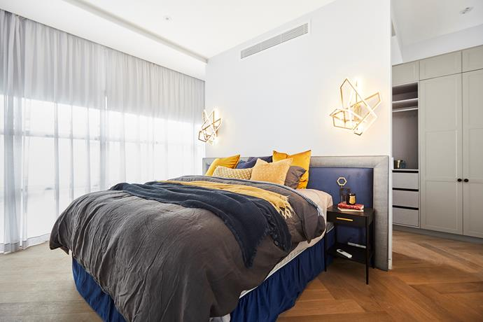 **Master bedroom -** The bold blue and yellow palette and the statement pendants in Norm and Jess' master bedroom were all a bit much for the judges who thought the style clashed with the rest of the apartment. An easy fix if the new owners feel the same.